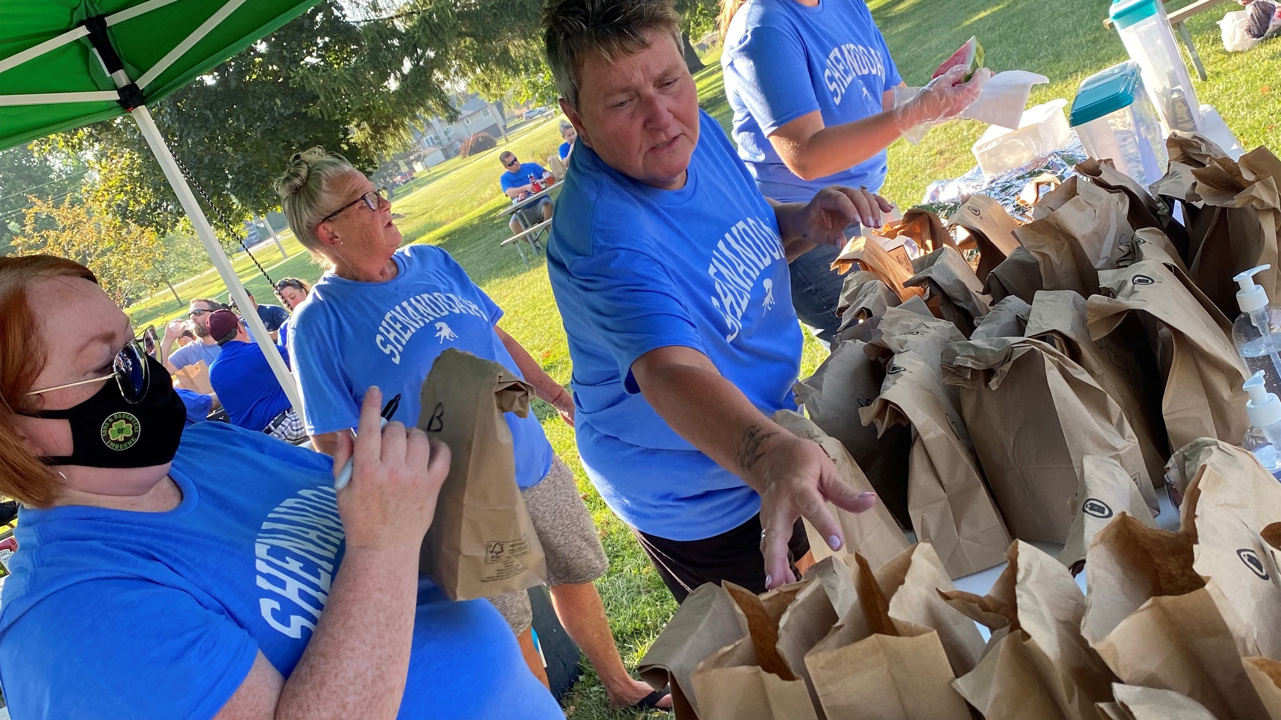Green Plains employees preparing sack lunches at the Community Cookout