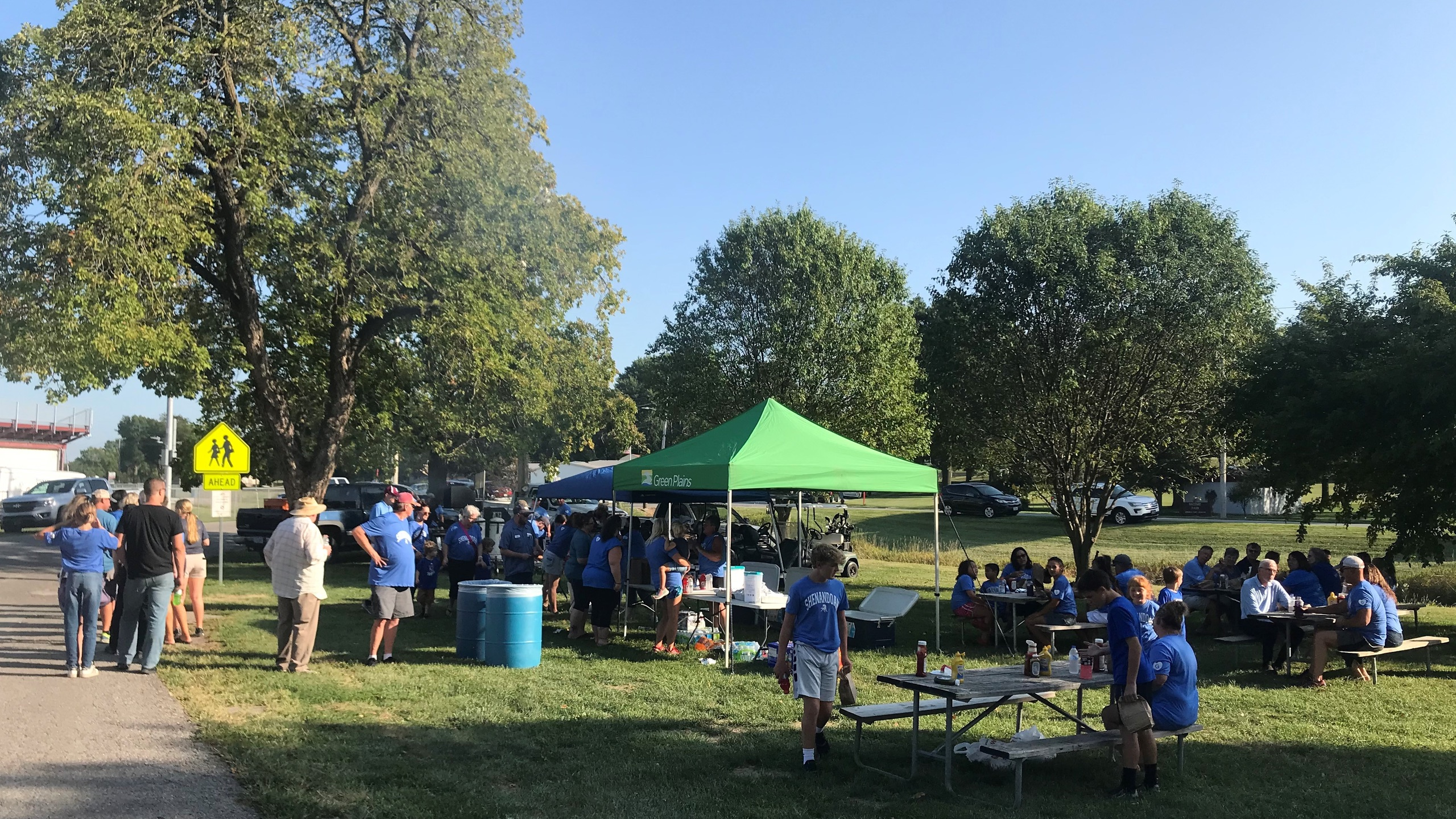 outdoor cookout scene with Green Plains tent